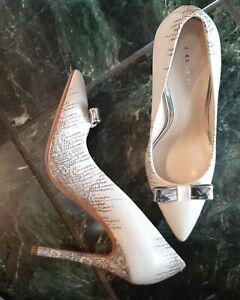 Coach New York size 7 B Hallie Lizard pointed Heels w/metal bow. Brand new w/bag