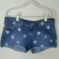 Levis blue denim cut off shorts festival boho star print, women's size 31 EUC