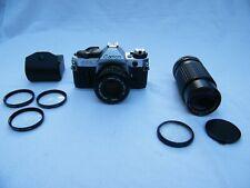 Canon AE-1 35mm SLR Film Camera Body, 2 Lenses, 3 Close-Ups, Sky Filter Bundle