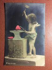 Antique Tinted Valentine postcard 1900s Cupid acting like blacksmith anvil heart