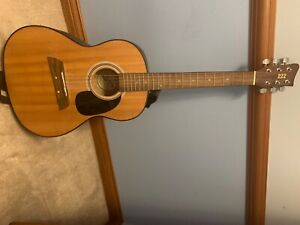 Acoustic Guitar (one string is missing but everything else is fine$
