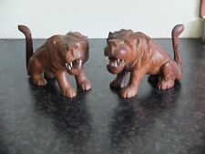 More details for two palm wood art deco lions