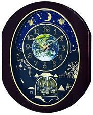 "Rhythm ""VELVET COSMOS"" Musical Magic Dial Motion Wall Clock 4MH428WU06"