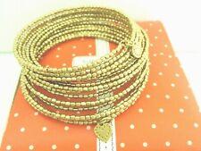"SM. ""Stella & Dot"" Gold Tone Spiral Bangle Bracelet signed in box"