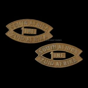 Pair of WW1 1st South African Infantry Brigade Shoulder Title Badges