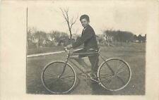 Real Photo Postcard~Boy w/Derby On Farm Land Stands Behind Bicycle Bike~Close-Up