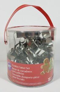 NIP Wilton 18 piece silver metal Holiday Christmas cookie cutter bucket set