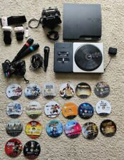 PS3 slim 120gb Console w/ 2 controllers 20 games & extras . PlayStation