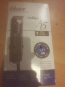 oster golden a5 brand new with blade andextras 1st class signed 4 on delivery
