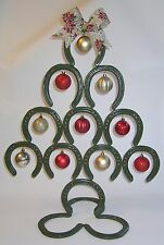 Pre-used Lucky Horseshoes welded together to form a Christmas Tree