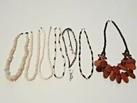 Lot of 7 Necklaces. shells, wood, and Cookie Lee crystal choker.