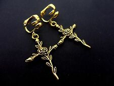 A PAIR OF GOLD COLOUR FLOWER CROSS CLIP ON EARRINGS. NEW.