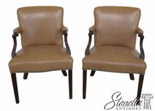 L46502: Pair Of Tan Leather Mahogany Open Arm Chairs