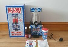 New used once Slush Puppie Machine and 2 new sealed syrups juices.