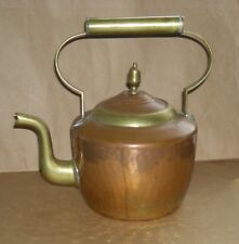 Antique copper kettle with brass detail lined with tin