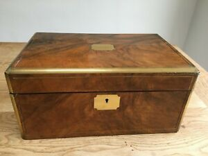 19th century walnut and brass bordered writing slope with inkwell & secret panel
