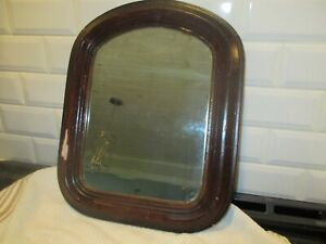 Antique arched small mirror. Solid wood back.