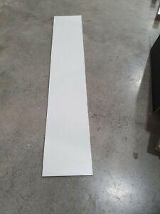 White melamine board 2400mm x 445mm x 16mm. 1 long side edged.