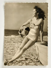 Vintage postcard girl in a swimsuit pin-up Germany on the beach 1950s