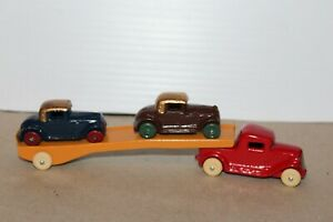 VINTAGE 1930's BARCLAY SLUSH MOLD CAR CARRIER TRUCK with MODEL A FORD COUPES