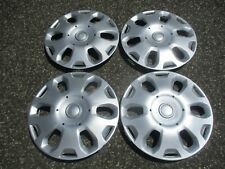 Genuine 2010 to 2013 Ford Transit Connect 15 inch hubcaps wheel covers set