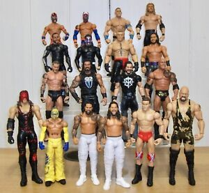 Set of 4 WWE wrestling figures inc. Roman Reigns, Drew McIntyre & Braun Strowman