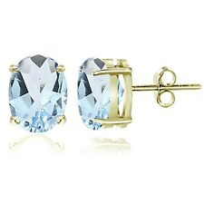 Gold Tone over Sterling Silver Blue Topaz 8x6mm Oval Stud Earrings