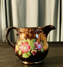Antique Copper Luster Creamer Wit Florals In Relief