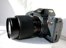 RICOH XR-X con zoom REVUENON 35-70 mm. 1:2,8 multi program