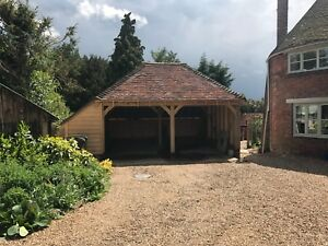 Two Bay Green Oak Fronted Catslide Garage with integrated log-store. 5.6m x 5.3m