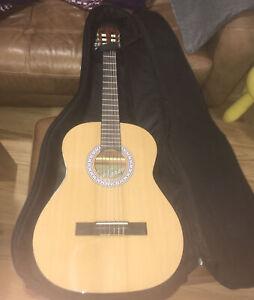 left Handed 3/4 acoustic guitar