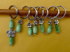 Stitch marker, knitting 6+1 units.  pewter flower and green shell