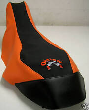 polaris outlaw 500 525 450 black GRIPPER/ orange  seat cover