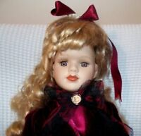 porcelain bisque vintage blonde doll 17 inch's tall with dress and velvet jacket