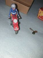 Fantastic and co wind up Motorcycle With Ryder. Modern reproduction of a classic