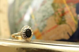 9ct yellow gold oval deep blue sapphire with round brilliant diamond halo ring