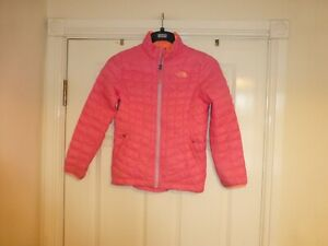 The North Face long sleeved pink padded zip up jacket Age 10-12, motif on front