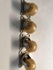 "vintage casters metal swivel amber color wheels Lot4-1 1/4"" wheels"