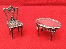 VINTAGE SILVER MINIATURE TABLE AND CHAIR. DOLLS HOUSE FURNITURE.