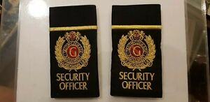 GUARDSMARK UK OFFICER Pair of  Black & Gold Epaulette sliders. Security.
