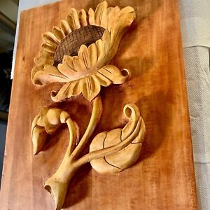 Wood carving with sunflower seed pattern