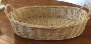 """Oval Wicker Basket With Handles 13"""" wide by 19""""long by 4"""" deep"""