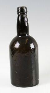 antique 18th Century dark green hand made glass bottle