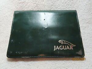 "JAGUAR XJ Series Drivers  handbook etc in green wallet ""~,"