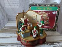 Trim a home Santa's workshop animated musical Xmas decor