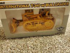 ERTL 1/16 SCALE DIE CAST INTERNATIONAL T-340 W/Bullgrader yellow, New in Box.