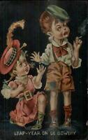 Leap Year Girl on Bent Knee Boy Child Smoking Cigarette c1910 Postcard