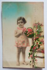 BABY WITH FLOWER HAND  COLORED REAL PHOTOGRAPH VINTAGE POSTCARD