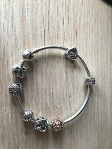 Pandora Moments Bangle with Charms. As new. 21cm.