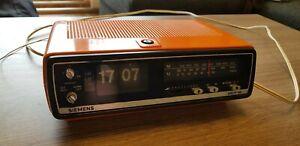 70er Klappzahlen Radiowecker Siemens alpha 24 RG221 orange Vintage Clip Clock